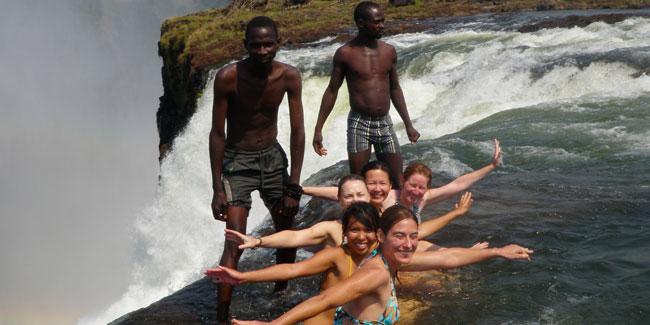 Swimming to the edge of Victoria Falls in Zambia